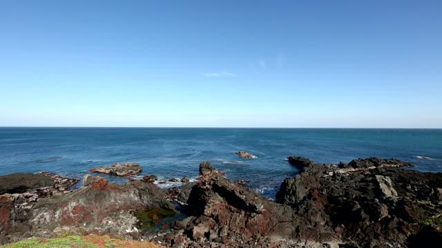stockvideo's en b-roll-footage met seascape at seopjikoji coast in seogwipo, jeju island, south korea - coastal feature