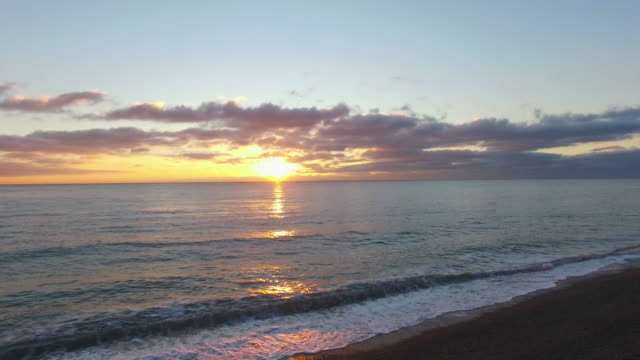 aerial: seascape at sunrise - overhead projector stock videos & royalty-free footage
