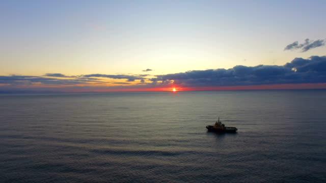 aerial: seascape at sunrise - industria della pesca video stock e b–roll