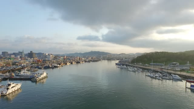 seascape of mokpo harbor with fishing village - fishing village stock videos and b-roll footage