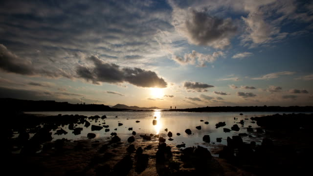 seascape with basalt and dramatic sky at sunset - basalt stock videos & royalty-free footage