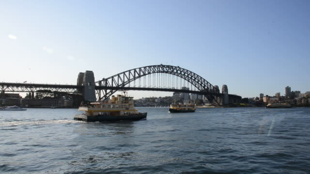 Seascape with ferry passes in front of Sydney Harbour Bridge
