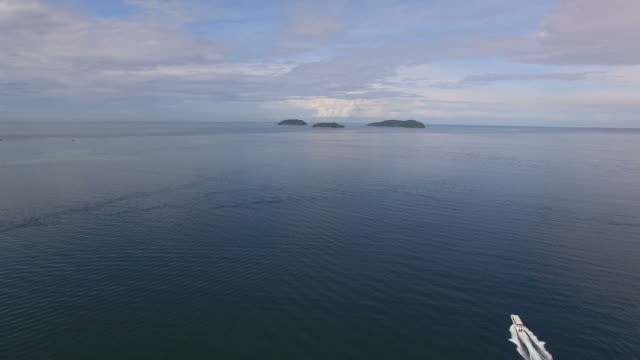 seascape with horizon over water and tourboat in kota kinabalu - tourboat stock videos & royalty-free footage