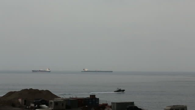 seascape with iranian oil tanker grace 1 at strait of gibraltar, gibraltar, uk, on friday, july 19, 2019 - 優美点の映像素材/bロール