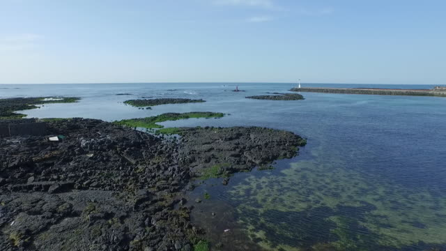 seascape with lighthouse and basalt - basalt stock videos & royalty-free footage