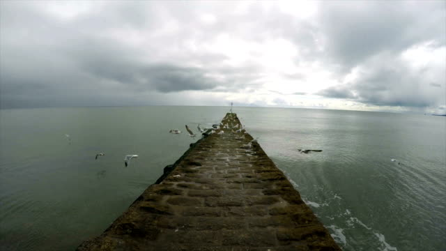seascape with stone pier - pier stock videos & royalty-free footage