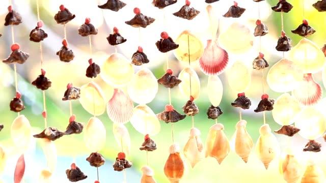 貝殻風モバイル - ベル点の映像素材/bロール
