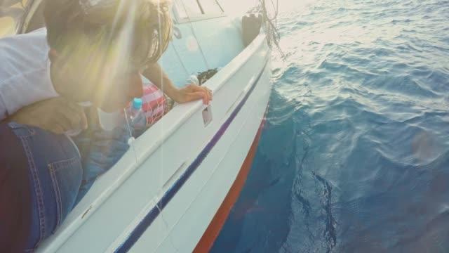 seasick man vomiting off side of boat - nausea stock videos & royalty-free footage