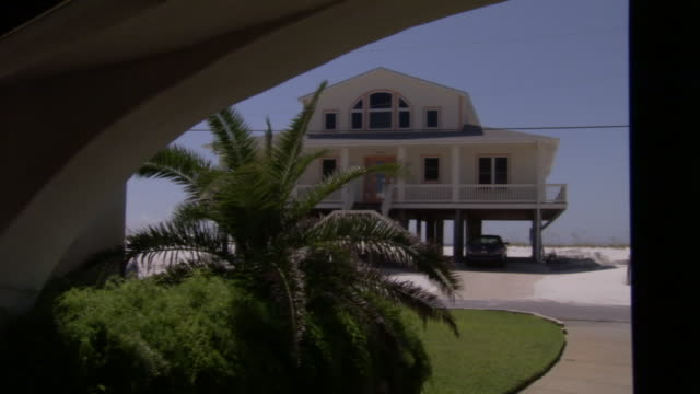 a seaside house is built on stilts - stilts stock videos and b-roll footage
