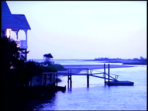 seaside house with pier - getönt stock-videos und b-roll-filmmaterial