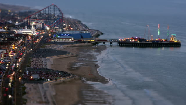 seaside time-lapse and blackpool pleasure beach - blackpool stock-videos und b-roll-filmmaterial