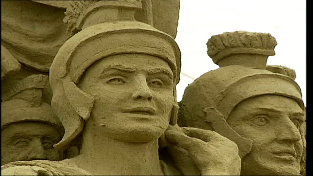 brighton; int close up of roman soldiers sand sculpture lion sand sculpture - sculpture stock videos & royalty-free footage