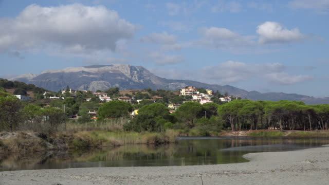 seaside village in front of mountain - spiaggia stock videos & royalty-free footage