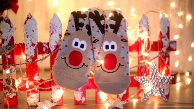 seasonal winter socks by th christmas decoration - sock stock videos & royalty-free footage
