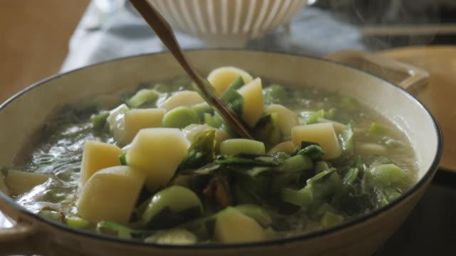 seasoning leek potato soup - potato soup stock videos & royalty-free footage