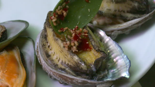 Seasoning putting on the abalone (Korean food)