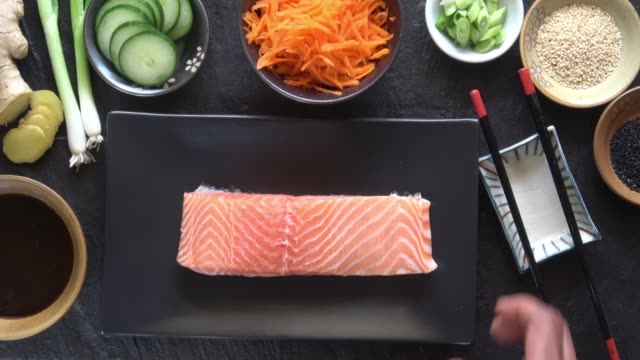seasoning raw salmon fillet with salt and pepper. - fillet stock videos and b-roll footage