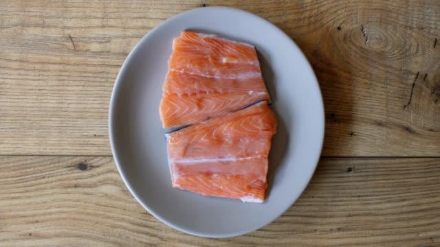 seasoning salmon fillet - plate stock videos & royalty-free footage