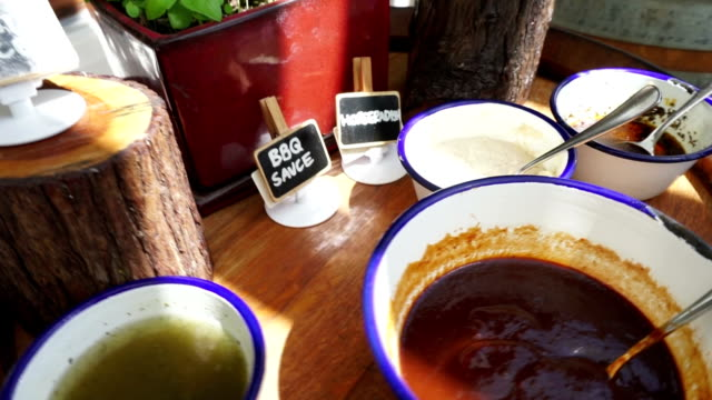 seasoning sauce on table - bbq sauce stock videos and b-roll footage