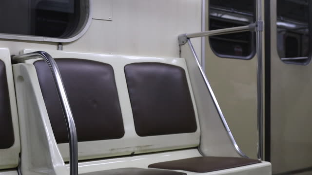 seat in a subway train - vehicle seat stock videos & royalty-free footage