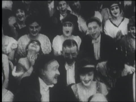 b/w 1915 seated audience in formalwear laughing + clapping - audience stock videos and b-roll footage
