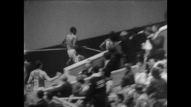seated crowd at san francisco's cow palace for all-american games / 60 yard dash begins / won by charles greene of nebraska / neal steinhauer of... - shot put stock videos & royalty-free footage