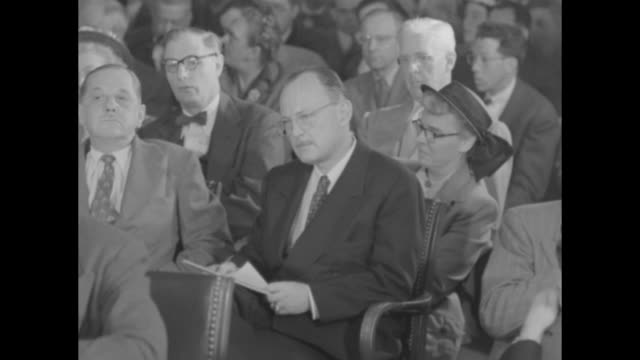 vídeos de stock, filmes e b-roll de seated in audience, author/scholar/former state department advisor owen lattimore takes notes during tydings committee testimony of louis budenz,... - note pad