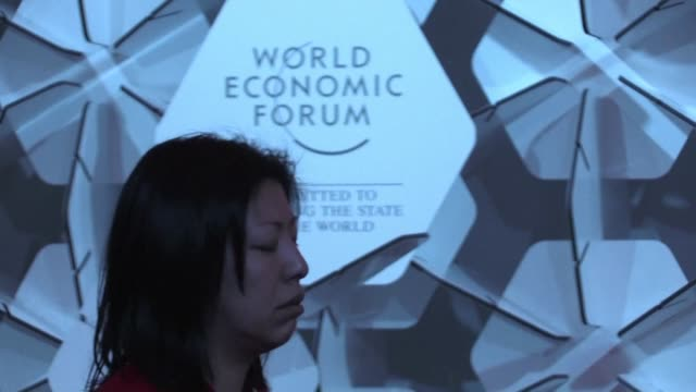 Seated in suits and ties with snowy treetops glistening through the window visitors to the Davos business summit listen to meditation leader Jayanti...