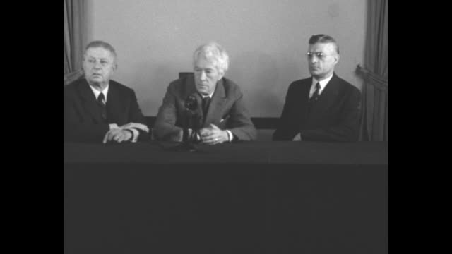 Seated left to right for photo opportunity John Heydler President of National League Judge Kenesaw Mountain Landis Baseball Commissioner and Will...