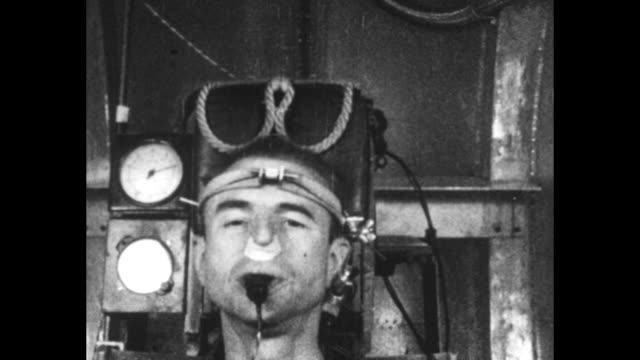 Seated man with measuring device strapped around his head exhales hard into rubber tube clenched in his mouth tape over his nostrils prevents air...