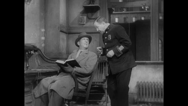 vídeos de stock, filmes e b-roll de 1931 seated middle class man orders gluten based sandwich from police officer - 1931