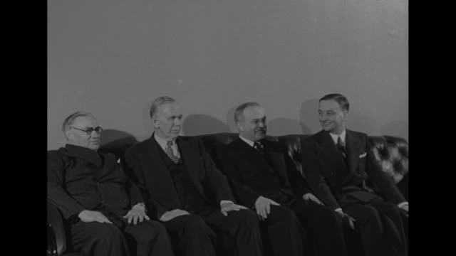 Seated on couch in room of Aero Club left to right British Foreign Secretary Ernest Bevin US Secretary of State George Marshall Russian Foreign...