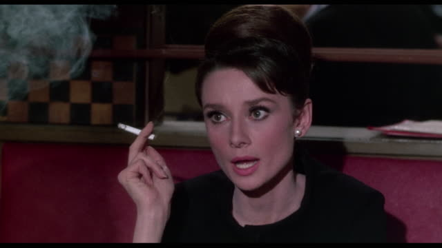 1963 seated, smoking and determined woman (audrey hepburn) announces she is leaving paris - audrey hepburn stock videos & royalty-free footage