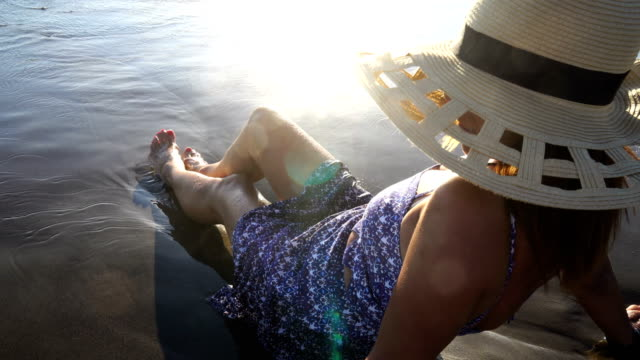 seated woman in sea