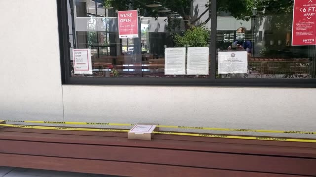 seating has been roped off with caution tape at a restaurant observing social distancing during an outbreak of the covid-19 coronavirus in san ramon,... - roped off stock videos & royalty-free footage
