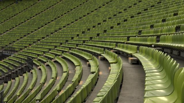 vídeos de stock e filmes b-roll de seating rows at olympic stadium, munich, bavaria, germany - assento