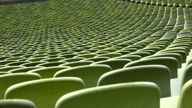 seating rows at olympic stadium, munich, bavaria, germany - tribuna video stock e b–roll