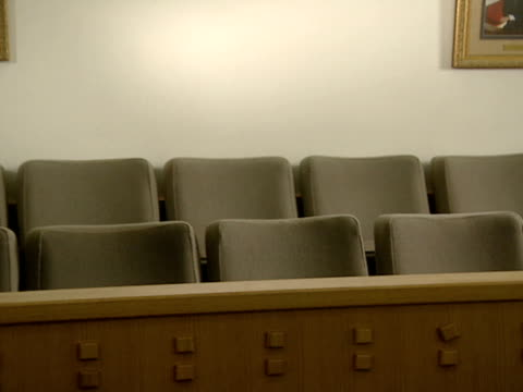 seats line a jurybox in an empty courtroom - jury box stock videos & royalty-free footage