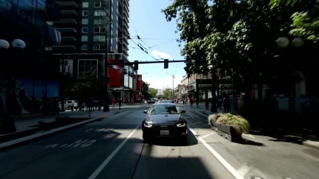 seattle city xvii synced series rear view driving process plate - trolley bus stock videos & royalty-free footage