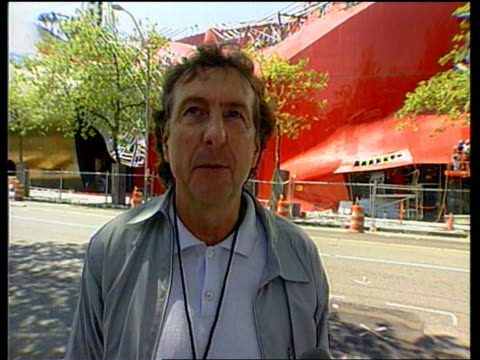 stockvideo's en b-roll-footage met seattle ext jimi hendrix music over shots tgv experience music project building la gv construction worker working on curved metal roof la gv red wall... - terry gilliam