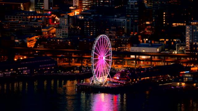 aerial seattle great wheel on the elliott bay waterfront at night - elliott bay bildbanksvideor och videomaterial från bakom kulisserna