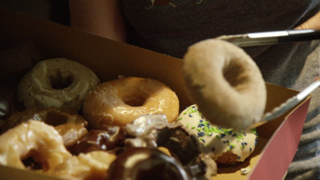 seattle made donuts - sprinkles stock videos & royalty-free footage