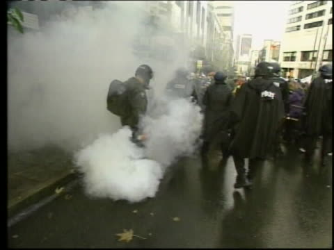 seattle police fire tear gas canisters at activists outside of the washington state convention center, during the 1999 seattle wto protests. - 1990 1999 stock videos & royalty-free footage