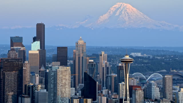 aerial seattle with glorious sunlit mount rainier in the background - seattle stock-videos und b-roll-filmmaterial
