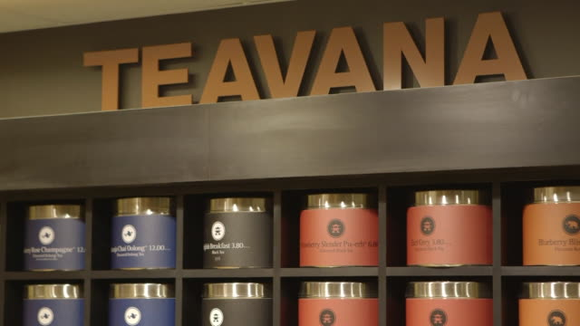 seattles best coffee and teavana signage at the starbucks headquarters in seattle washington united states on october 19 wide shot of teavana signage... - bombola video stock e b–roll