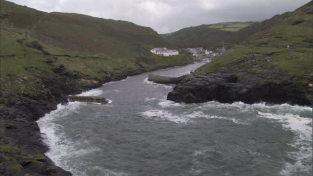 seawater flows into an inlet on a rugged english coast. - inlet stock videos & royalty-free footage