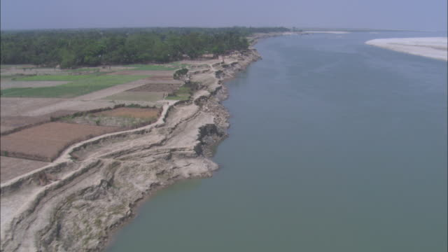 Seawater moves along the coast of the Sundarbans in Bangladesh. Available in HD.