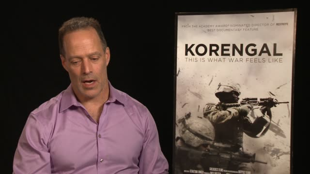 vídeos y material grabado en eventos de stock de interview sebastian junger on the film being nonpolitical at the 'korengal' los angeles press junket at the four seasons hotel on june 03 2014 in... - korengal tal