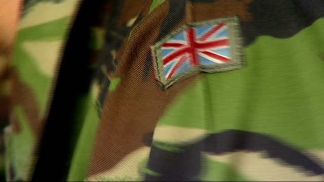 second battalion rifles prepare for deployment to kosovo more shots of troops signing documents and handed items of kit close shot of union badge on... - sleeve stock videos & royalty-free footage
