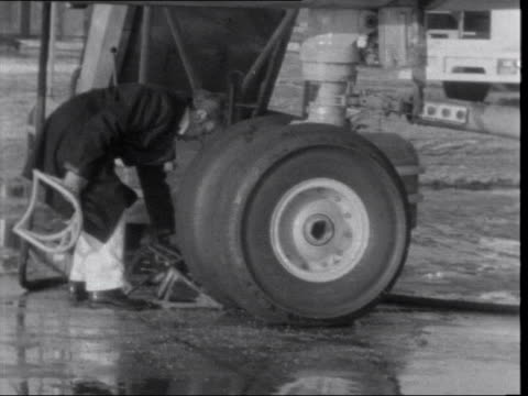 second day of two day boac pilots strike pan along idle vc10 at lap ms chocks put under wheel ms ms man into balpa building ms men working inside... - captain stock videos and b-roll footage